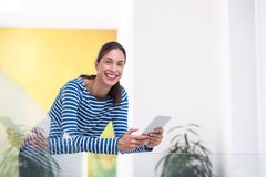 Young woman at home websurfing Royalty Free Stock Images