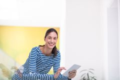 Young woman at home websurfing Stock Image