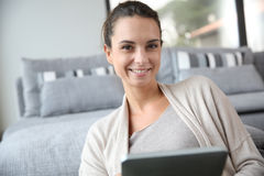 Young woman at home websurfing on tablet Stock Photography