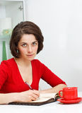Young woman at home writing Royalty Free Stock Photography