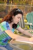 Young woman homework Stock Image