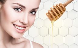 Young woman prepare for honey facial mask. Royalty Free Stock Photos