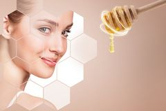Young woman and honey spoon prepare for facial mask. stock image