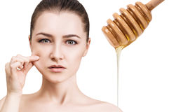 Young woman prepare for honey facial mask. Stock Photo