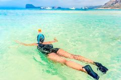 Young woman in honeymoon with snorkeling mask dive underwater with tropical fishes in coral reef sea pool. Royalty Free Stock Photos