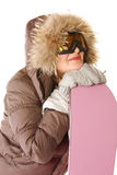 Young woman in hood with snowboard Royalty Free Stock Image
