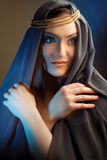 Young woman with hoody and folded hands thinking. royalty free stock photos