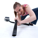 Young woman with hoover Stock Photography