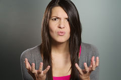 Young woman with a horrified expression Royalty Free Stock Image