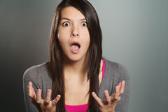 Young woman with a horrified expression stock photos