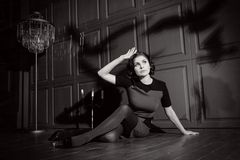Young woman in horror movie. At black and white Royalty Free Stock Photography