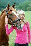 Young woman with horse Stock Images