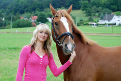 Young woman with horse Royalty Free Stock Images