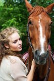 Young woman and horse Royalty Free Stock Photos
