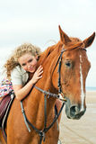 Young woman on a horse stock images