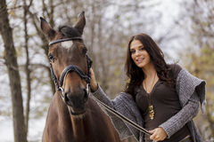 Young woman and a horse Royalty Free Stock Images