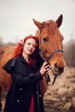 Young woman and a horse. Royalty Free Stock Photo