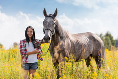 Young woman with a horse Stock Photography