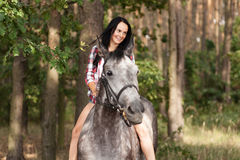 Young woman with a horse Stock Photo