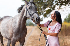 Young woman with a horse Royalty Free Stock Photography