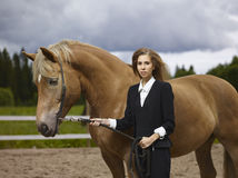 Young woman and horse Stock Image