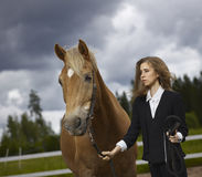 Young woman and horse Stock Photography