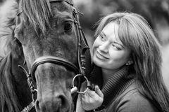 Young woman with a horse Royalty Free Stock Images