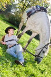 Young woman with a horse on the field Stock Photo