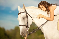 Young woman on a horse. Horseback rider, woman riding horse on b Royalty Free Stock Photography