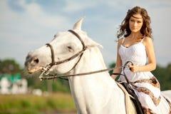 Young woman on a horse. Horseback rider, woman riding horse on b. Beautiful woman on a horse. Horseback rider, woman riding horse on beach Royalty Free Stock Photos