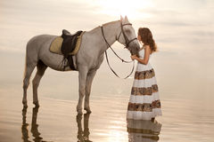 Young woman on a horse. Horseback rider, woman riding horse on b Royalty Free Stock Photos