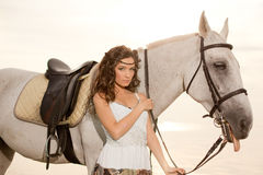 Young woman on a horse. Horseback rider, woman riding horse on b Stock Photos