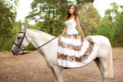 Young woman on a horse. Horseback rider, woman riding horse Stock Photo