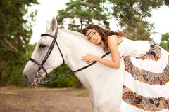 Young woman on a horse. Horseback rider, woman riding horse. Beautiful woman on a horse. Horseback rider, woman riding horse Royalty Free Stock Image