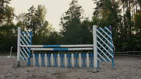 Young woman on horse jumping over obstacles. Slow motion. Training horses before the competition. Horse Racing. Horse stock footage