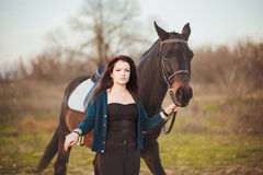 Young woman with a horse on nature Royalty Free Stock Photography