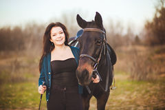 Young woman with a horse on nature Stock Photo