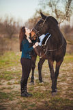 Young woman with a horse on nature Royalty Free Stock Photos