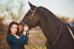 Young woman with a horse on nature stock images