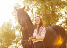 Young woman with a horse Stock Photos
