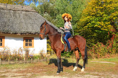 Young woman on a horse Royalty Free Stock Image