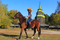 Young woman on a horse Royalty Free Stock Photos