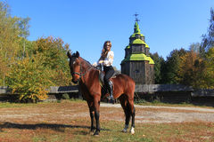 Young woman on a horse Royalty Free Stock Photography