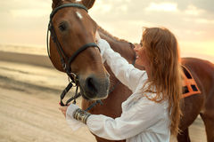 Young woman with horse on sea cost Stock Photography