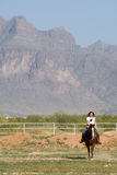 Young woman on horseback Stock Image