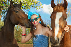 Young woman with a horses Stock Photos