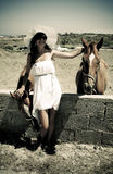 Young woman with horses in Greece Royalty Free Stock Image