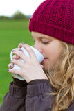 Young woman with a hot beverage Royalty Free Stock Image
