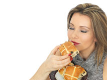 Young Woman With Hot Cross Buns Royalty Free Stock Image