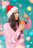 Young woman with hot drink Stock Images